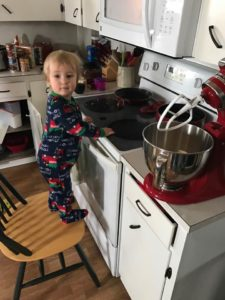 Child helping make cookies.