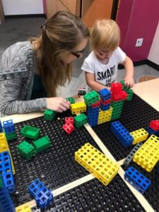 mom and daughter playing with block at the children's museum.